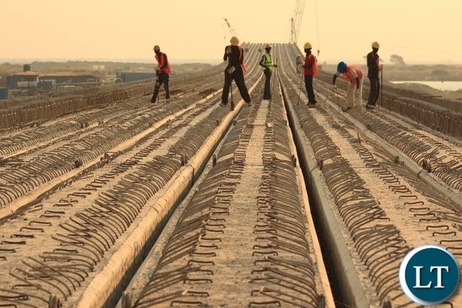 Works underway on top of the main bridge across the Zambezi River on the Mongu-Kalabo Road Project.