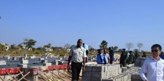 Eastern Province Minister Malozo Sichone being led by China Jiangxi Project Manager Cai Jiado Nash when he inspected a K44 million project of a boarding school under construction in Chasefu of Lundazi District