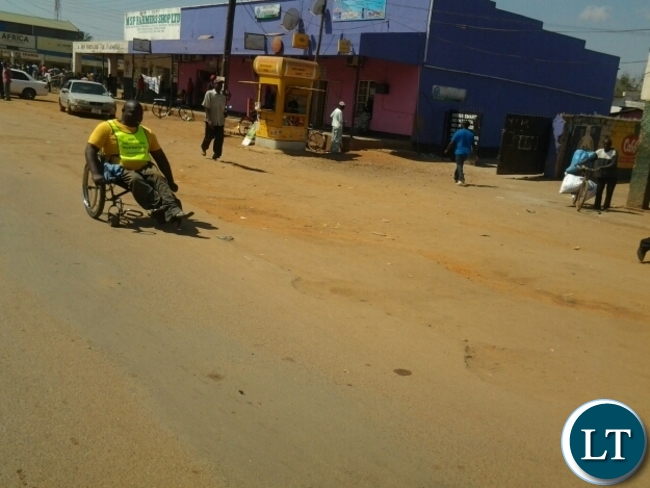 John Nyati taking part in the Choova Wheelchair race in Chipata