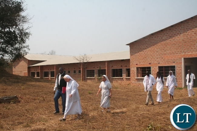 North-Western province medical officer Dr Simulyamana Choonga (l) with Luwi mission hospital founderess Dr Heide Brauckmann and hospital administrator sister Caritas Kang (third left) during the tour of newly constructed Luwi nursing school in Mwinilunga