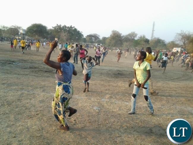 Soccer fans invading the Slam ground after Dushambe FC scored against Mambwe Warriors FC in Mfuwe at Kavulamungu sponsored tournament