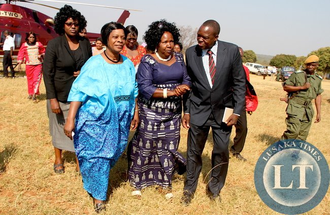 First Lady Esther Lungu flanked by Community Development , Mother and Child Health Deputy minister Josphine Limata (C) and Kaoma District Commissioner Robert Chiseke (r) on arrival at Mutondo Basic School for the Outreach Programme for People with Special needs in Mangango, Western Province on Monday, August 17,2015 -Picture by THOMAS NSAMA/STATE HOUSE