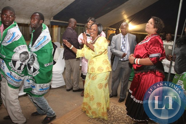 First Lady Esther Lungu could not resist the music by Kings Mumbi during the Meet the First Lady fundraising dinner dance to raise funds for the construction of PF permanent office in Mongu on Friday, August 14,2015 -Picture by THOMAS NSAMA