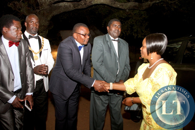 First Lady Esther Lungu speaks with Western Province  chairman Charles Mututwa secretary  on during the Meet the First Lady fundraising dinner dance to raise funds for the construction of PF permanent office in Mongu on Friday, August 14,2015 -Picture by THOMAS NSAMA