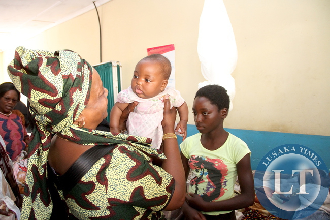 First Lady Esther Lungu holds one of the twins during a tour of Sioma Mission Rural Health Centre on Tuesday, August 25,2015 -Picture by THOMAS NSAMA