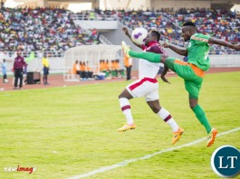 Nkana striker Jimmy Ndhlovu (l) battles for the ball with Zesco United defender Ayo Oluwafemi (r).