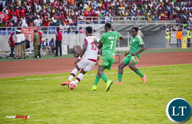 Nkana striker Walter Bwalya(l) battles for the ball with Zesco's Justin Zulu foreground) and Winston Kalengo (r)