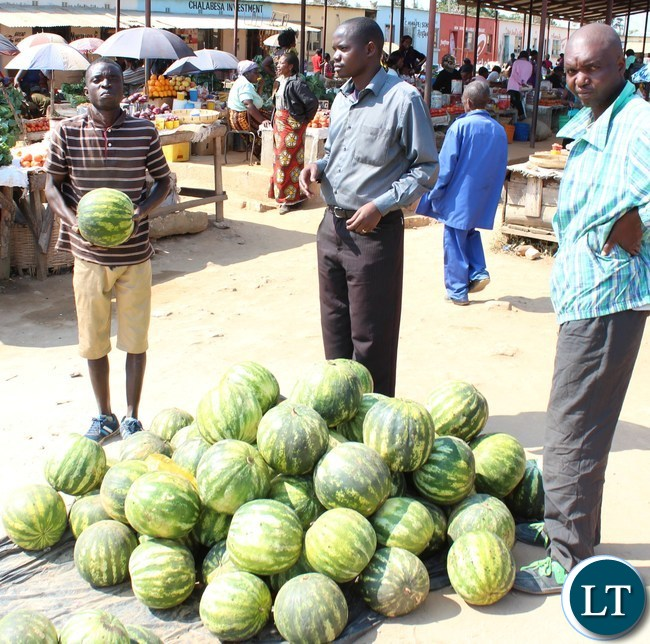 A trader at Serenje Market lures customers to buy his water melons.