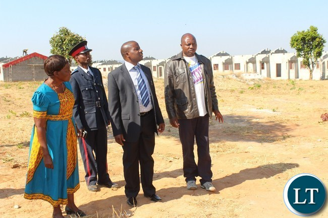 usakanya ward councillor  Christine Chewe ( l ) Mfuwe Member of Parliament Mwimba Malama ( c ) Mpika Buildings Officer Christopher Kanto ( r) during an inspection tour of Katibunga boarding secondary school in Mpika District which is under construction by Shannai Constrcutors at a cost of K45 million.