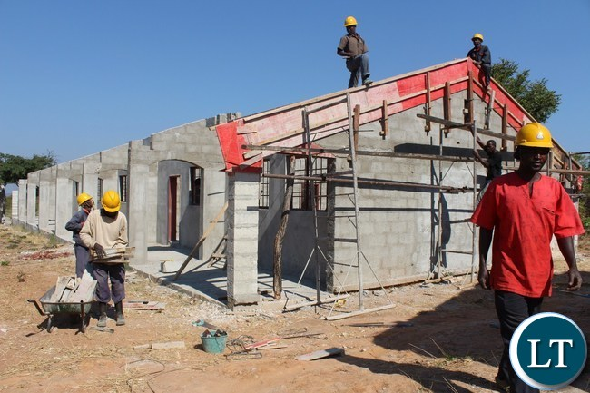 Shannai Constructors workers working on a classroom block at the on-going construction works of a K45 million Katibunga boarding secondary school in Mpika District of Muchinga Province.