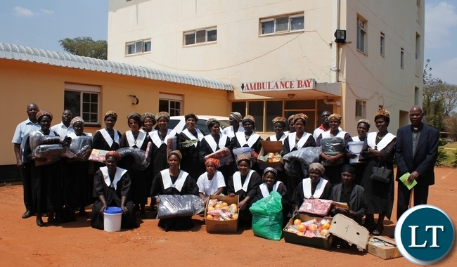 Members of The African Methodist Episcopal Church pose for a photo outside the Hospital Administration Block before presenting the donations to Mbala General Hospital and patients