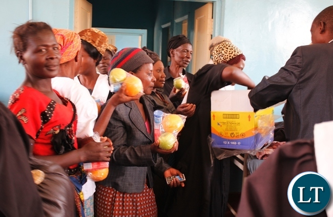 Mothers of sick children admitted to Mbala General Hospital (Children's Ward) receiving food stuffs donated by The African Methodist Episcopal Church