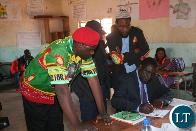 -Opposition United Party for Nation Development (UPND) Solwezi west parliamentary by- election candidate Teddy Kasonso (m) filling in his nomination papers for the forth-coming by-elections at Mwaji Mwambwe primary school in Solwezi on Wednesday. Picture by BETRAM KAOMA /ZANIS