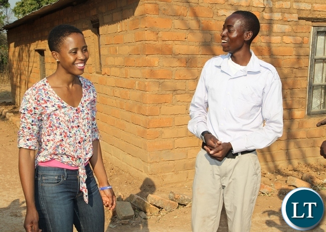President Lungu's daughter Tasila Lungu shares a light moment with Leston Mwalupanga at his farm in Mwange, Mporokoso. Miss Tasila Lungu is on an invitation of touring the UNICEF and government sponsored youth programmes in Northern Province. Leston is a beneficiary of Mwange Youth Resettlement scheme funded by government and UNICEF.