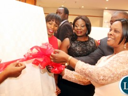 First Lady Esther Lungu (C) frees balloons to mark the official launch of the Women Banking Initiative assisted by Access Bank Managing Director Tunde Balogun (L) and the Bank's Head -Corporate Communications Tabitha Mvula (R) at Pamodzi Hotel in Lusaka on Friday evening, August 7,2015 -Picture by THOMAS NSAMA/STATE HOUSE