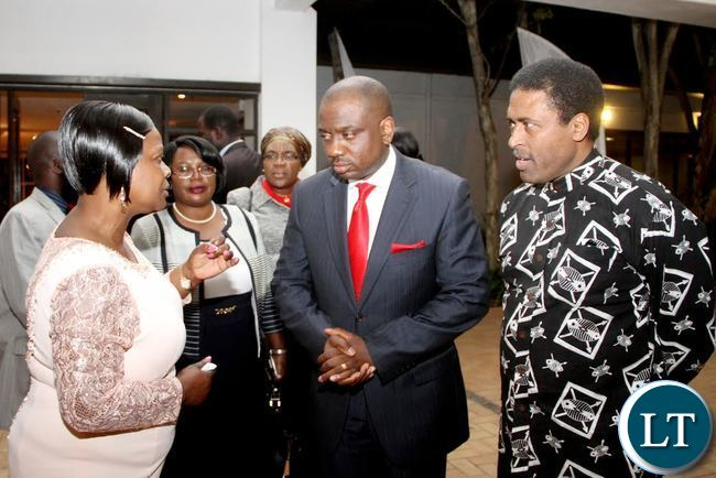 First Lady Esther Lungu (L) with Access Bank Managing Director Director Tunde Balogun and Private Sector Association Chairperson Yusuf Dodia (R) and Bank of Zambia Deputy Governor Administration Dr Tukiya Kankasa-Mabula (second from left) during a Launch of ACCESS Bank Women Banking Initiative at Pamodzi Hotel in Lusaka on Friday evening, August 7,2015 -Picture by THOMAS NSAMA/STATE HOUSE