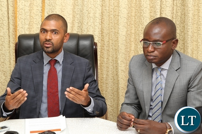 Acting Government spokesperson Vincent Mwale who is also Minister of Youth and Sports with Special Assistant for Press and Public Relations to the President Amos Chanda during the briefing at State House
