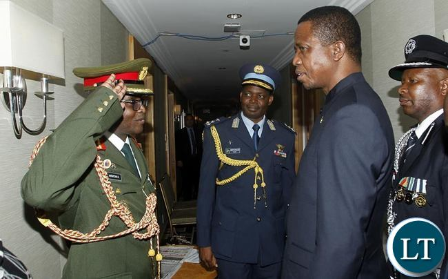 President Edgar Chagwa Lungu (second from right) being welcomed by his Defence Attaches Brigadeer General Erick Mwenya (left) Henry Mukuka (centre) at Palace Hotel in New York on Thursday,September 24,2015. PICTURE BY SALIM HENRY/STATE HOUSE ©201