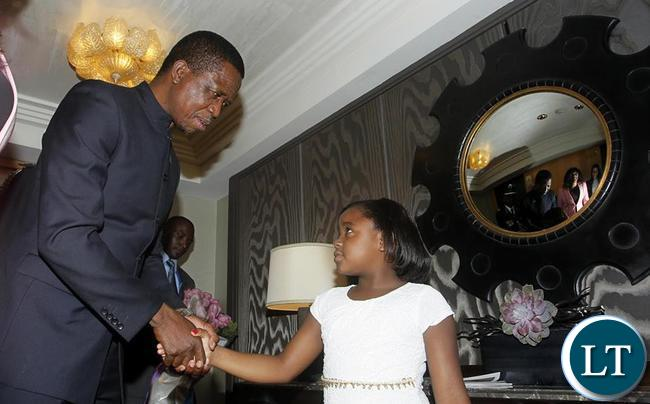 President Edgar Chagwa Lungu (left) greets eight year old Vanessa Brown Mwanza at Palace Hotel in New York on Thursday,September 24,2015. PICTURE BY SALIM HENRY/STATE HOUSE ©2015