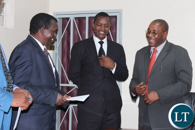 Zambezi Region Council Leadership of Namibia, Governor Col. Lawrence Sampofu (r) charts with Western Province Minister Poniso Njeulu (c) and his Permanent Secretary Mwangala Liomba (l) during a courtesy call at the minister's office in Mongu