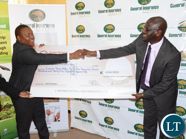 General Insurance Limited Managing Director Charles Nakhoze handover the cheque of K3, 042, 735 to Zambia National Farmers Union Executive Director Ndambo Ndambo during the handover of LIMA Credit Scheme Insurance pay-out