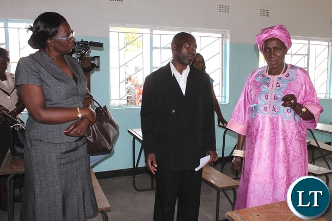 Vice President Inonge Wina (r) talking to Kataba Primary School Head teacher Munalula Mubiana (c) and Western Provincial Education Officer Loveness Lubasi (l) inside a new class room during the official opening of a 1x 2 class room block worth k160,000 at Kataba Primary School in Nalolo District