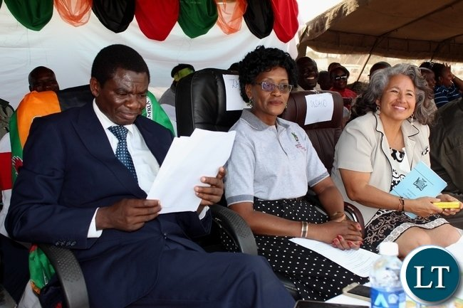 Education Deputy Minister David Mabumba (l), Zambia National Education Coalition (ZANEC) Member Organisation representative Gina Chiwela (c) and USAID Zambia Education Office Chief Iris Young (r) during the celebration of International Literacy Day at Mulambwa Primary School in Mongu