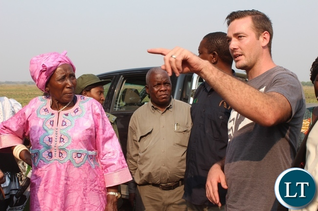 The Zambia Project Site Manager Jaycee Coetee (l) showing Vice President Inonge Wina (c)  the site for the construction clinic by Dignity Zambia, a charitable organization based in Australia, in Nalolo District