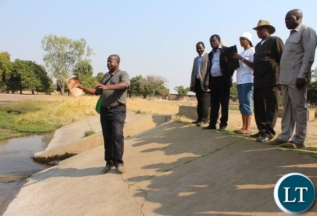 Sefula Irrigation Scheme Camp Extension Officer Angelo Silumesii (front) showing the Zambezi Region Council Leadership of Namibia and Zambian delegation the water source of irrigation canals during the tour of the agriculture projects in Mongu