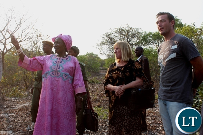 The Zambia Project Site Manager Jaycee Coetee (l) leading Vice President Inonge Wina (c) to the site for the construction clinic by Dignity Zambia, a charitable organization based in Australia, in Nalolo District