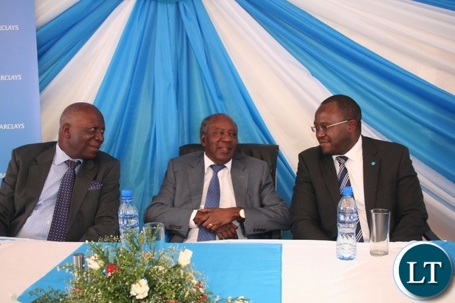 Finance minister Alexander Chikwanda (m) with Barclays Bank Zambia Board chairman Jacob Sikazwe (I) and Barclays Zambia managing director during the official opening of Barclays Solwezi Branch