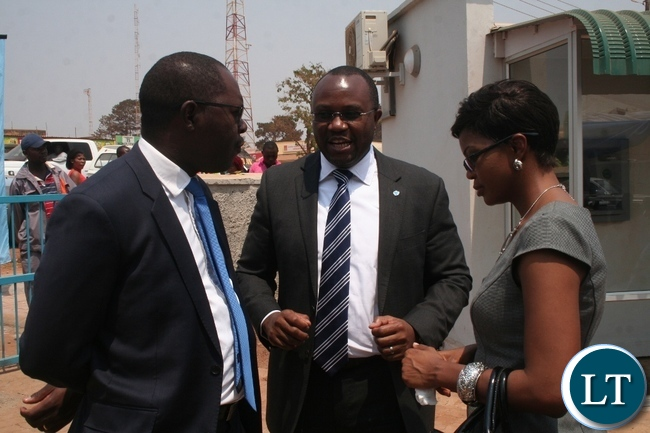 Barclays Zambia managing director Saviour Chibiya (m ) with Barclays Bank chief operating officer Vincent Chuunga and Barclays Bank chief of staff and strategy executive officer Mwaka Mutambo during the official opening of Barclays Solwezi Branch