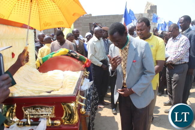 Monze District Commissioner Mr. Cyprian Hamanyanga pays his last respects to late Bweengwa Central ward Councilor Mr. Gladson Maungila during burial