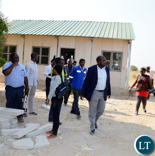HEALTH deputy Minister Chitalu Chilufya (in a jacket) inspects Siankope rural health post in Choma yesterday which was among the 650 facilities under construction countrywide. Picture by CHILA NAMAIKO