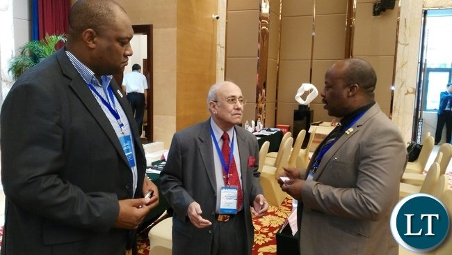 ROAD Transport and Safety Agency (RTSA) director Zindaba Soko (right) and his Deputy for Safety Gladwell Banda (left) listens to International Road Federation (IRF) President Kiran Kapila during the IRF and China Highway and Transportation Society (CHTS) congress and annual meeting in Chongqing, China, recently