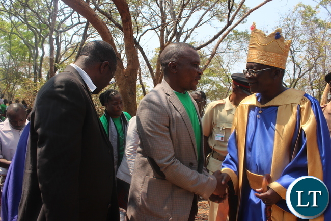 Chiefs and Traditional Affairs Deputy Minister John Kufuna (Middle) congratulates Chief Ngabwe VI (right) after his coronation as Kapiri Mposhi MP Eddie Musonda looks on.