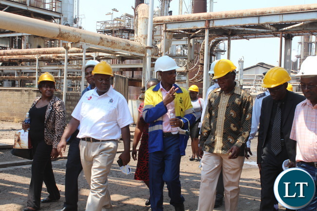 Commerce Trade and Industry Permanent Secretary, Siazongo Siakalenge , accompanied by District agriculture coordinator ,Mwanji Chela,(right) who was representing the acting District Commissioner Ngoni Moyo, director of industry ,ministry of Commerce Trade and Industry(far left) and other senior government officials and district heads of departments lead by Nitrogen Chemicals of Zambia Chief executive Zuze Banda (middle) during a tour of Nitrogen Chemicals of Zambia plant in Kafue.