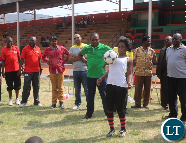 Airtel Talent search hopeful Chadiza Day Secondary G 10 Evelyn Banda showing off her juggling skills while looking on are FAZ President Kalusha Bwalya followed by FAZ Committee member Lee Kawanu and Minister of Youth and Sport Vincent Mwale at Eastern Province Chipata David Kaunda Stadium on Saturday, September 26th.