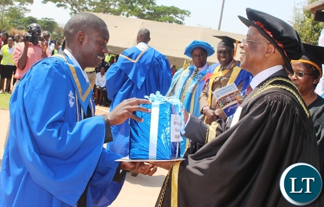 Students raise their diplomas during the Immaculata Teachers College fourth graduation ceremony in Kabwe