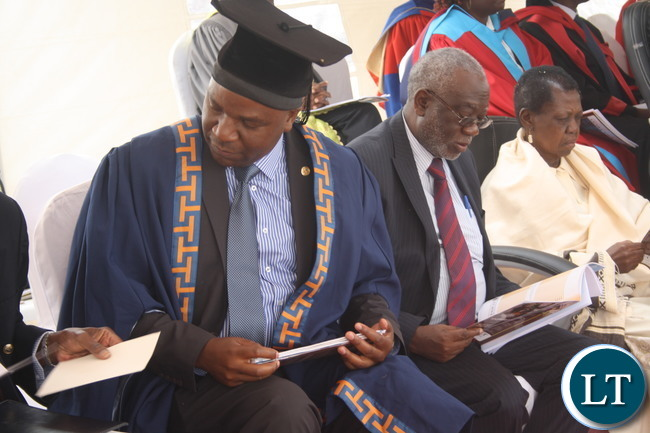 Labour Minister - Hon Fackson Shamenda follows programme at recent ZAOU's 7th Graduation Ceremony at OYDC