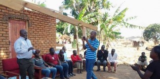 Lundazi business executive Evans Ngoma addressing women at Tikolane Women Club (not in picture) in Lundazi