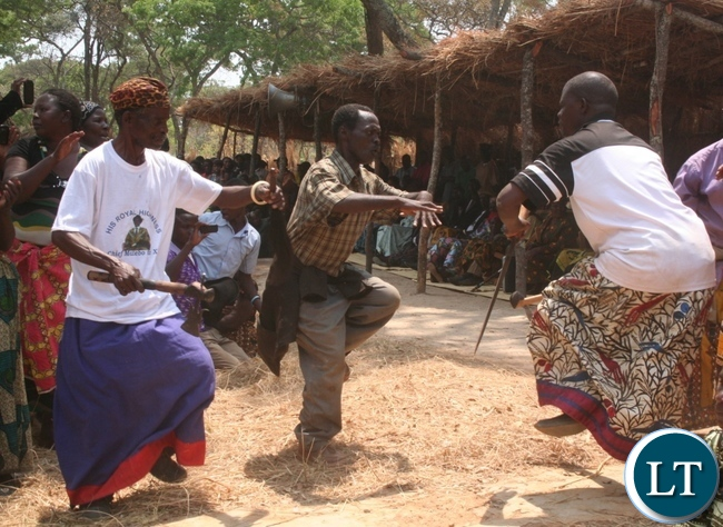 Chief Matebo's royal family members engage in dancing the song entitled beauty is made and fined locally known as Buya Balatwa during the Kuvuluka Kishakulu tradition ceremony at chief Matebo's grounds in Solwezi