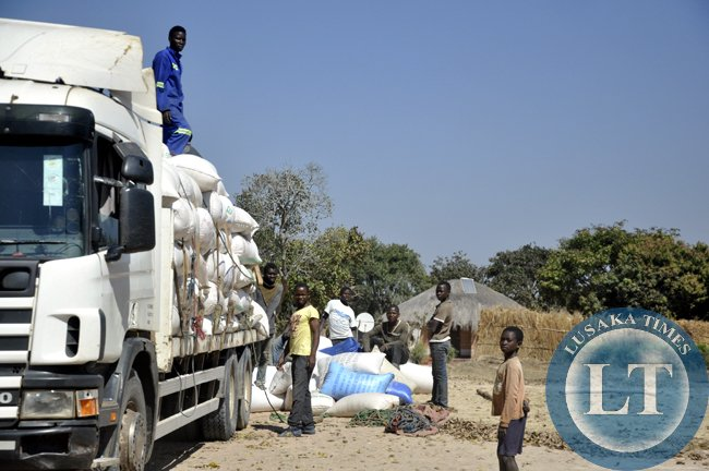Peasant farmers load their maize into a truck before transportation to an FRA depot in chief Mulala's area. Agriculture faces manay challenges in the area and this fuels poverty
