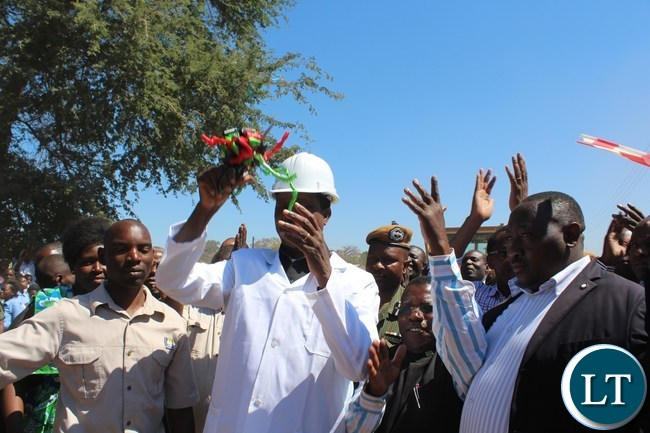 President Edgar Lungu cuts the ribbon during the ground breaking ceremony for Bottom road lot two (2) in Sinazeze area in Sinazongwe district