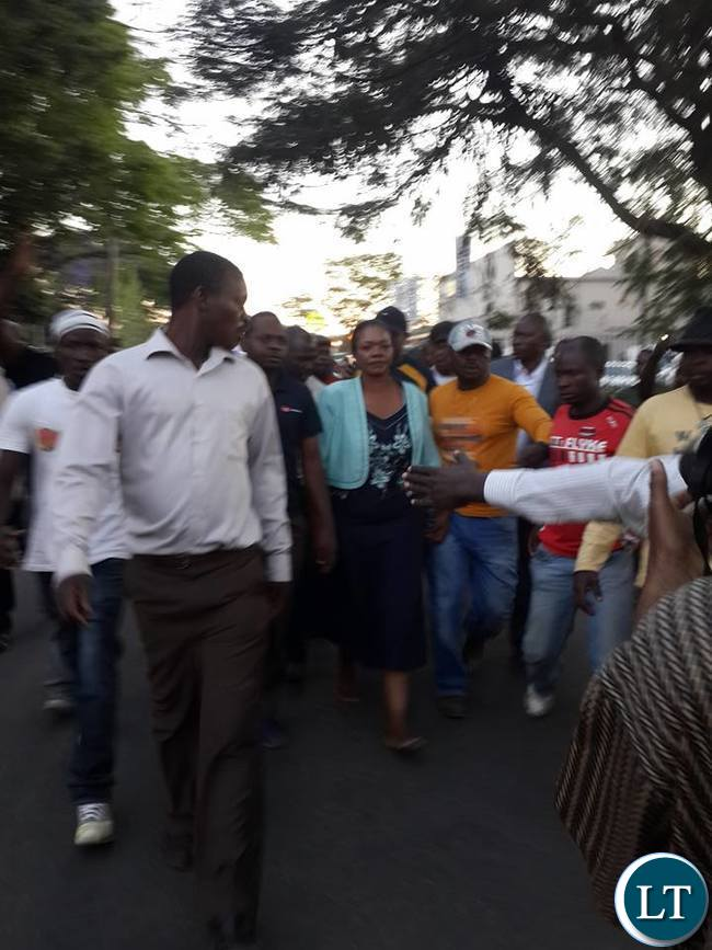 Slyvia Masebo walks out of Woodlands Police Station enroute to Central Police