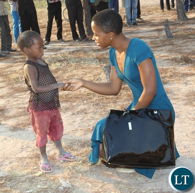 President Lungu's daughter greets a child of Musa village in Kasama where she was in the entourage of UNICEF who were touring projects in the area.