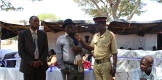 Senior Chief Monze ( middle in black hat) speaking during the official hand over of five computers worth K22,500 by the Zambia National Building Society(ZNBS) at Namuseba Primary School in Monze