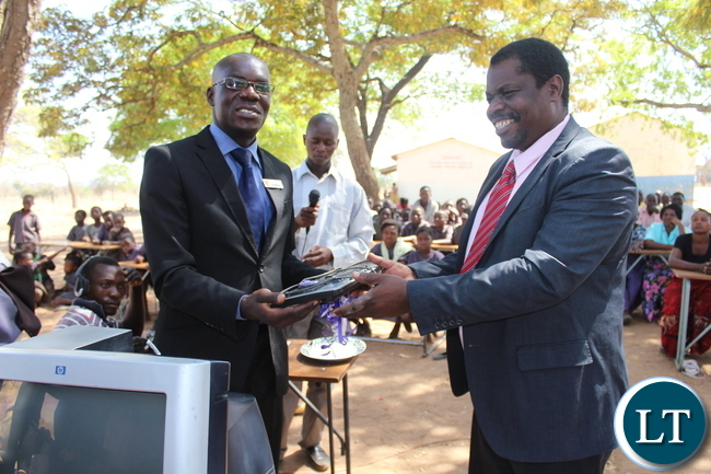 Zambia National Building Society (ZNBS) Mazabuka Branch Manager Mr. Jimmy Phiri (left) officially hand over five computers worth K22, 500 to Monze District Education Board Secretary Mr. Vimbi Mateke (right). The computers were donated after Namuseba Primary School authorities made a request for assistance to ZNBS for the equipment to enhance ICT learning at the school.