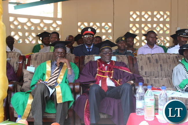 """AGRICULTURE and Fisheries Permanent Secretary Dr David Shamulenge(seated Right) and Monze District Commissioner Mr. Cyprian Hamanyanga(seated left) watch proceedings at the Zambia College of Agriculture's (ZCA) 4th Diploma and 64th Certificate General Agriculture graduation ceremony held under the theme, """"Continued Innovation and Quality Agriculture Training Beyond the Golden Jubilee Year"""" in Monze"""