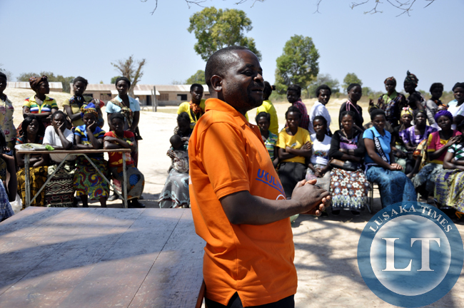 ZCSD Executive Director Lewis Mwape address women's groups at Chief Chungu's palace in Luwingu